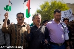 Bassem Tamimi (centre) in Bil'in village with Abdullah Abu Rahma (right)