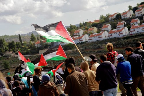 marchers and settlement - Tamimi Press